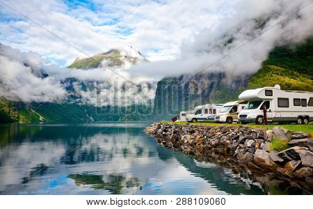 Camper van recreational vehicles (RV) parked at norwegian campsite on a fjord coast, Norway, Scandinavia