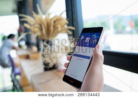 Chiang Mai, Thailand - Sep. 08,2018: Man Holding Huawei With Facebook App On The Screen. Facebook Is