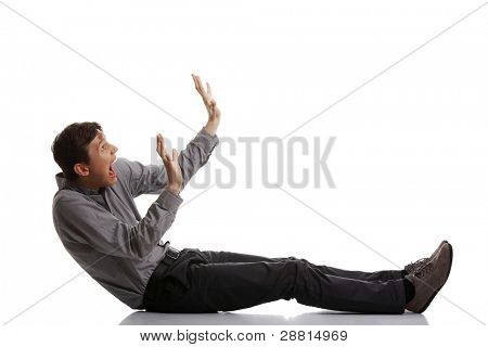 Scared young businessman isolated on white