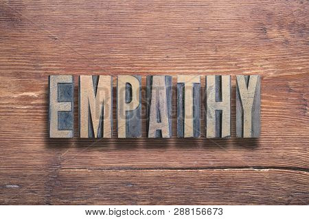 Empathy Word Combined On Vintage Varnished Wooden Surface