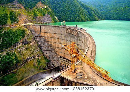 Enguri Hydroelectric Power Station Dam In High Mountains. One Of Highest Dam Of Hydro Power Plant In