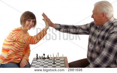 Grandad And Granddaughter Make A Compromise In Chess Game