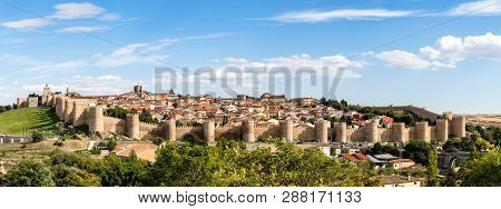 Panoramic View Of The Historic City Of Avila From The Mirador Of Cuatro Postes, Spain, With Its Famo