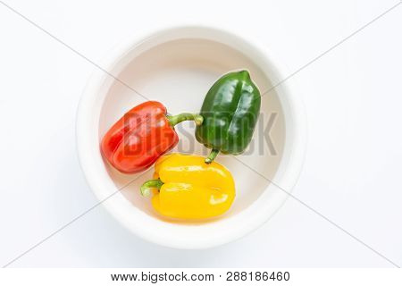 Bell pepper soaked in water. Washing fresh vegetables on white background. poster