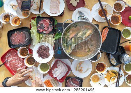 People Enjoy Eating Shabu Sukiyaki, Japanese Food Together Top View. Sukiyaki Shabu Hot Pot Meal Wit