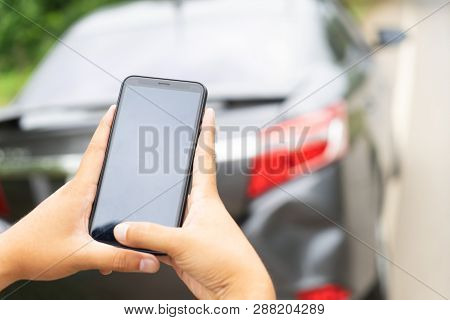 Man Hand Taking Photo Car Accident With Smartphone. Insurance Agent Using Smart Phone To Take A Phot
