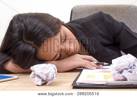 Young Business Woman Sleep At Work. Overworking  Asian Girl On Desk In Office, Stressed From Work Ov