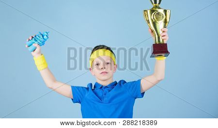 Happy Child Sportsman Hold Champion Cup. Fitness And Diet. Energy. Gym Workout Of Teen Boy Champion.
