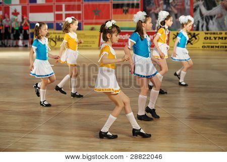 MOSCOW - MAY 4: unidentified Girls dance step at IX World Dance Olympiad in Sokolniki, on May 4, 2011 in Moscow, Russia. 21 305 dancers from 31 countries and 165 cities participated in Olympiad.