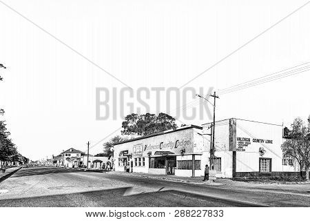 Brandfort, South Africa, August 2, 2018: A Street Scene, With A Lodge, Bank And Other Businesses, In