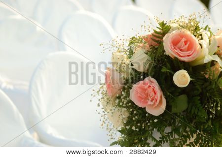 Wedding Bouquet And White Chairs