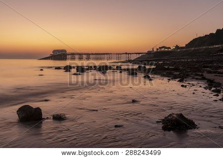 Mumbles Pier In Swansea At Dawn , South Wales