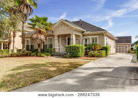 Typical Single Floor American House With Front Yard And Spacious Driveway Exterior Street View