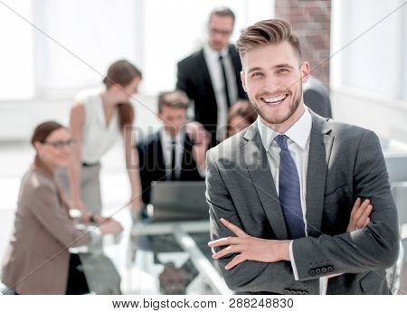 successful businessman standing in the Bank office