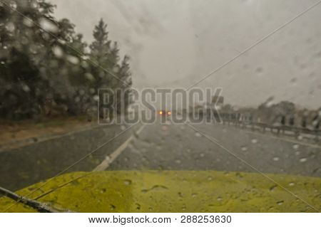 Deluge Of Rain In A Sudden Strom Whilst Driving On The Motorway.  Heavy Rain On The Windscreen And T