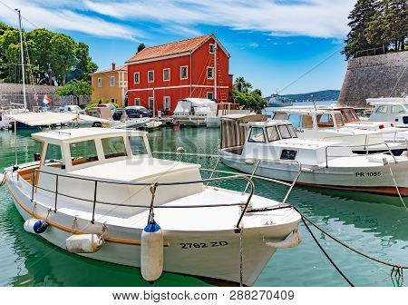 Zadar, Croatia - July 14, 2017: Pleasure Boats And Fishing Boats On The Pier In Fosa Bay In The Spa