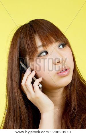 Stock Photo: Young woman talking by mobile phone. Portrait of asian woman.