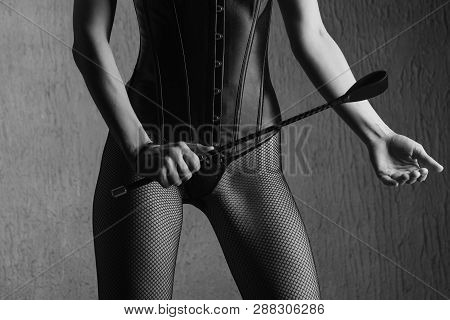 Sexy Lady In Bdsm Outfit. Beauty Dominant Woman With Spank In Leather Corset.- Image