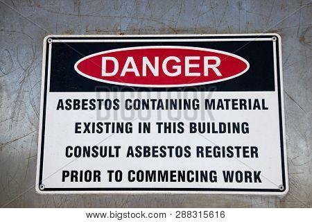 An Asbestos Warning Sign Highlighting The Dangers Of Asbestos Containing Materials.