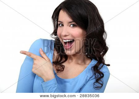 Woman pointing and laughing