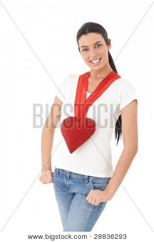 Romantic girl wearing red heart necklace at Valentine's day, smiling.?