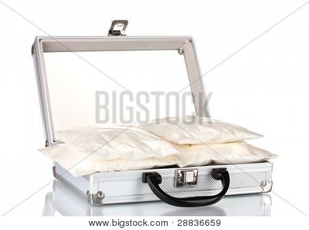 Cocaine in a suitcase isolated on white