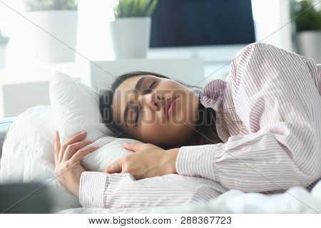 Beautiful Indian Woman Peacefully Lying In Bed Sleeping Early Morning While Alarm Clock Going To Rin