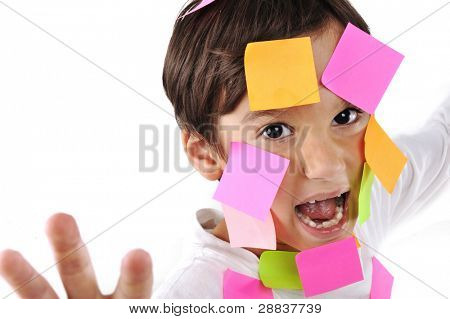 Little boy in panic with memo posts on his face