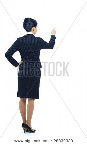Smiling business woman pointing and presenting, full length portrait isolated on white background.