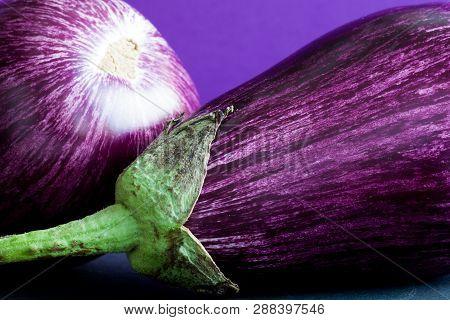 Ripe Purple Eggplants Macro View Pattern Texture. Beautiful Organic Food Colorful Background.