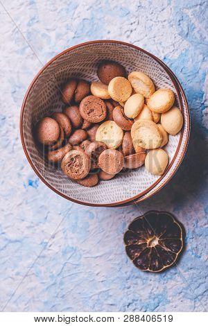 Several Sponge Biscuits In Bowl On Light Wooden Board