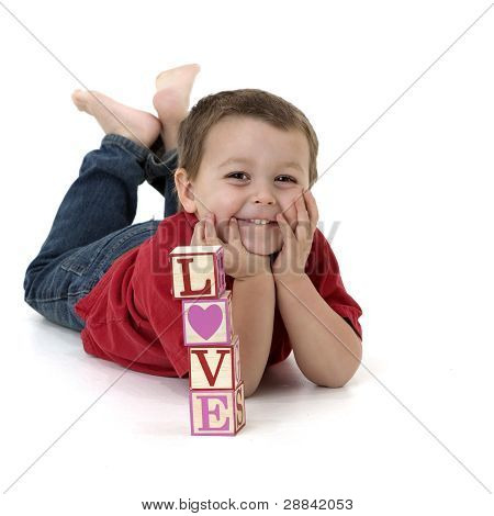 little boy with blocks that spell