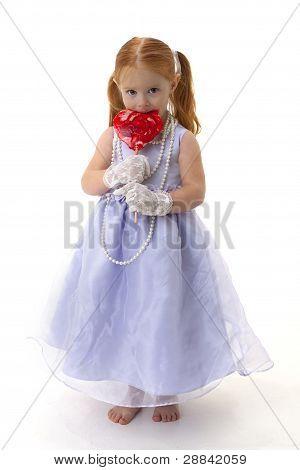 little girl with giant heart sucker