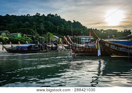 Koh Phi Phi, Thailand - November 2018: Boats Lined Up At The Edge Of The Island At Dawn, Morning Sun