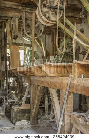 Traditional Artisan Wooden Flour Mill Equipment, Viewed From Side And Other Mill Pully Equipment.