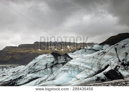 The Ice Is Streaked With Volcanic Ash And Soot In Iceland