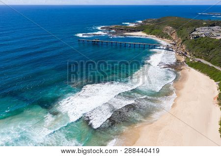 Aerial View Of Catherine Hill Bay Showing The Beach And The Old Coal Loading Pier. This Area Was His
