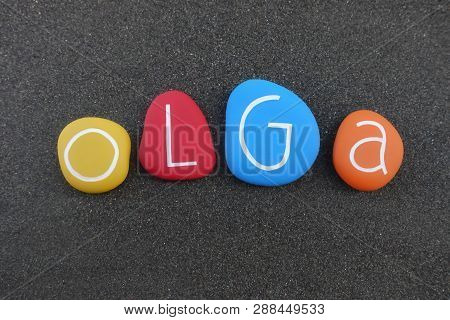 Olga, Feminine Given Name Composed With Multi Colored Stones Over Black Volcanic Sand