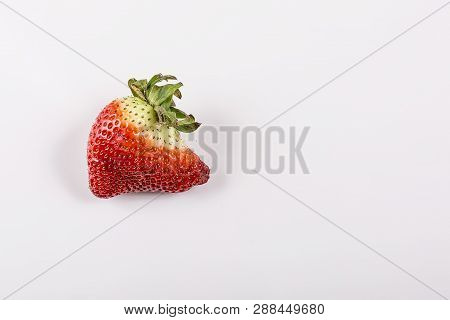 Ugly Organic Strawberries Isolated On White Background