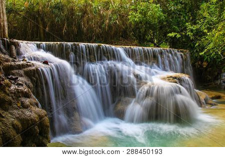 Water Flowing Over The Cascades At Kuang Si Waterfall Outside Of Luang Prabang In Laos. This Waterfa