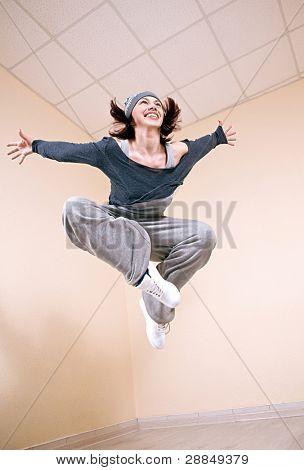 Teenage girl dancing hip-hop studio series.