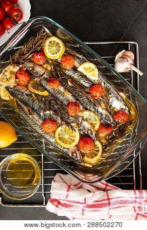 Dish Of Mackerel With Potatos On Black Background