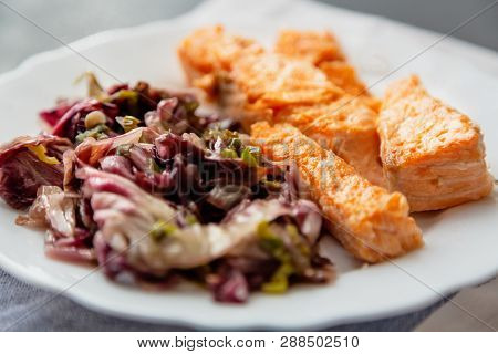 Baked Salmon With Prawns And Honey Sauce With A Side Dish Of Salad Mix Close-up On A Plate On A Tabl