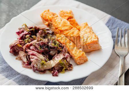 Plate With Salmon And Red Radicchio Garnish
