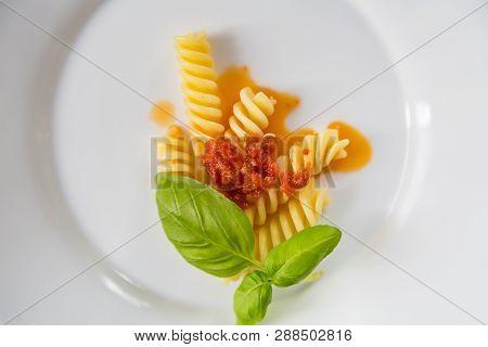 Dish Of Tasty Pasta On White Background