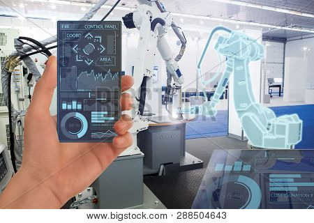 Engineer Uses A Futuristic Transparent Smartphone To Control Robots In A Smart Factory. Smart Indust