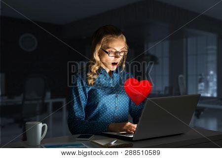 Surprised Beautiful Girl Looking In Glowing Laptop Screen. Mixed Media