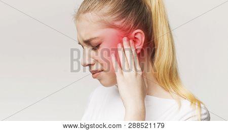 Tinnitus. Profile Of Sick Female Having Ear Pain, Touching Her Painful Head, Panorama
