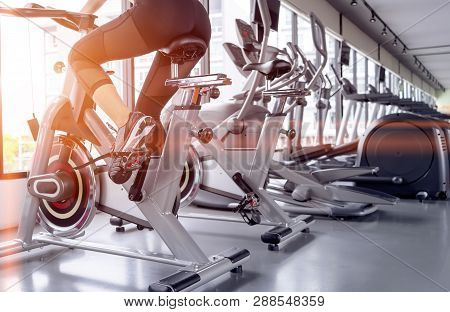 Exercise Bike Cardio Workout At Fitness Gym Of Woman Taking Weight Loss With Machine Aerobic For Sli