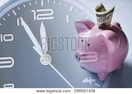 Savings, Investment Or Nest Egg Concept With A Pink Piggy Bank In A Composite Image With The Dial Of